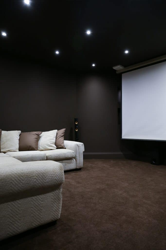 home cinema in the basement, black walls and ceiling