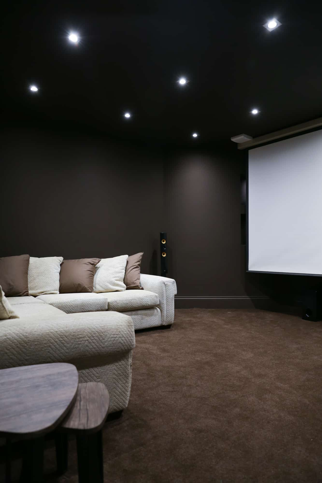 conversion of the basement into a home cinema, black walls and ceilings
