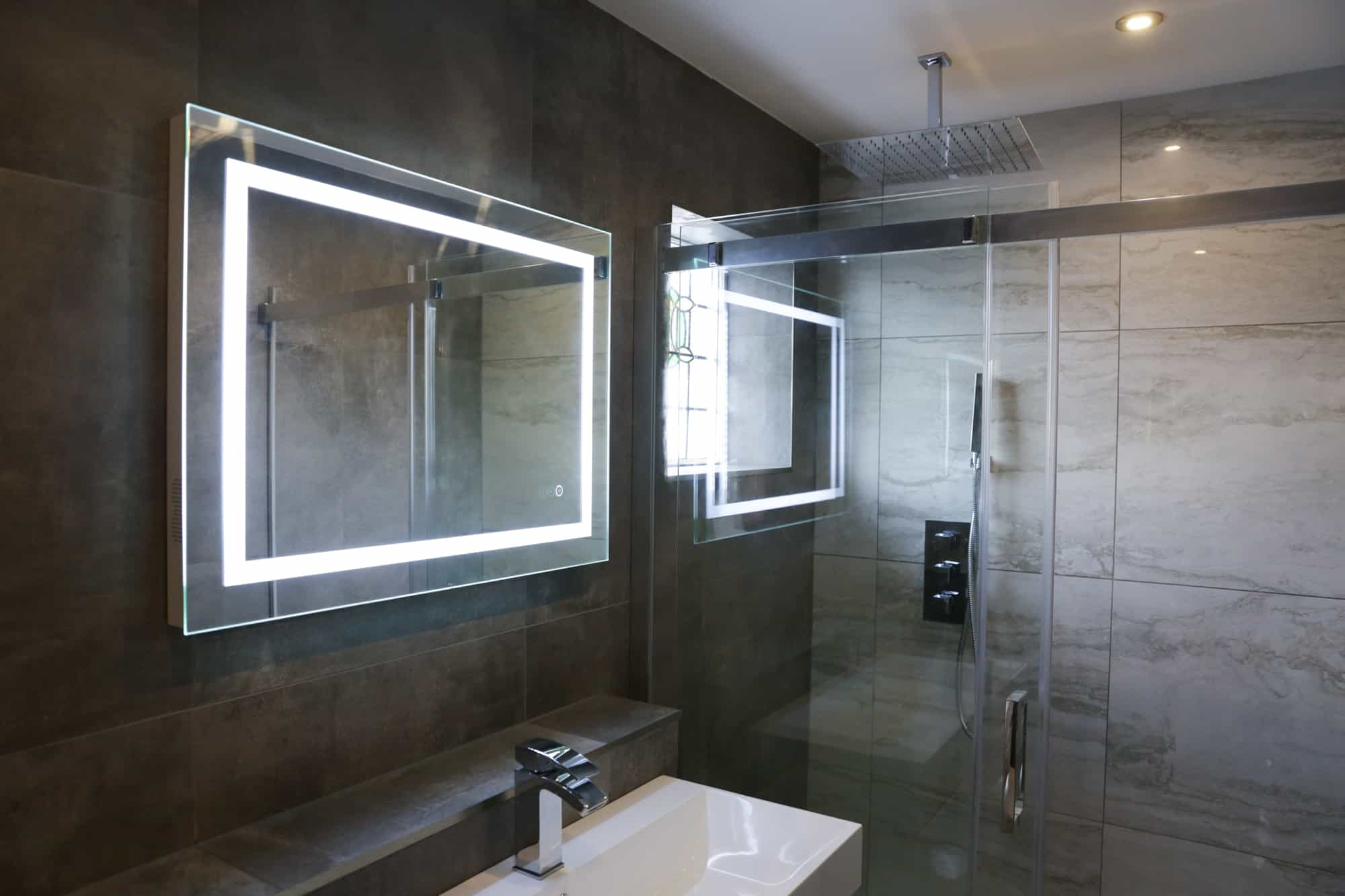 mirror, sink, shower in renovated bathroom by FIX LTD