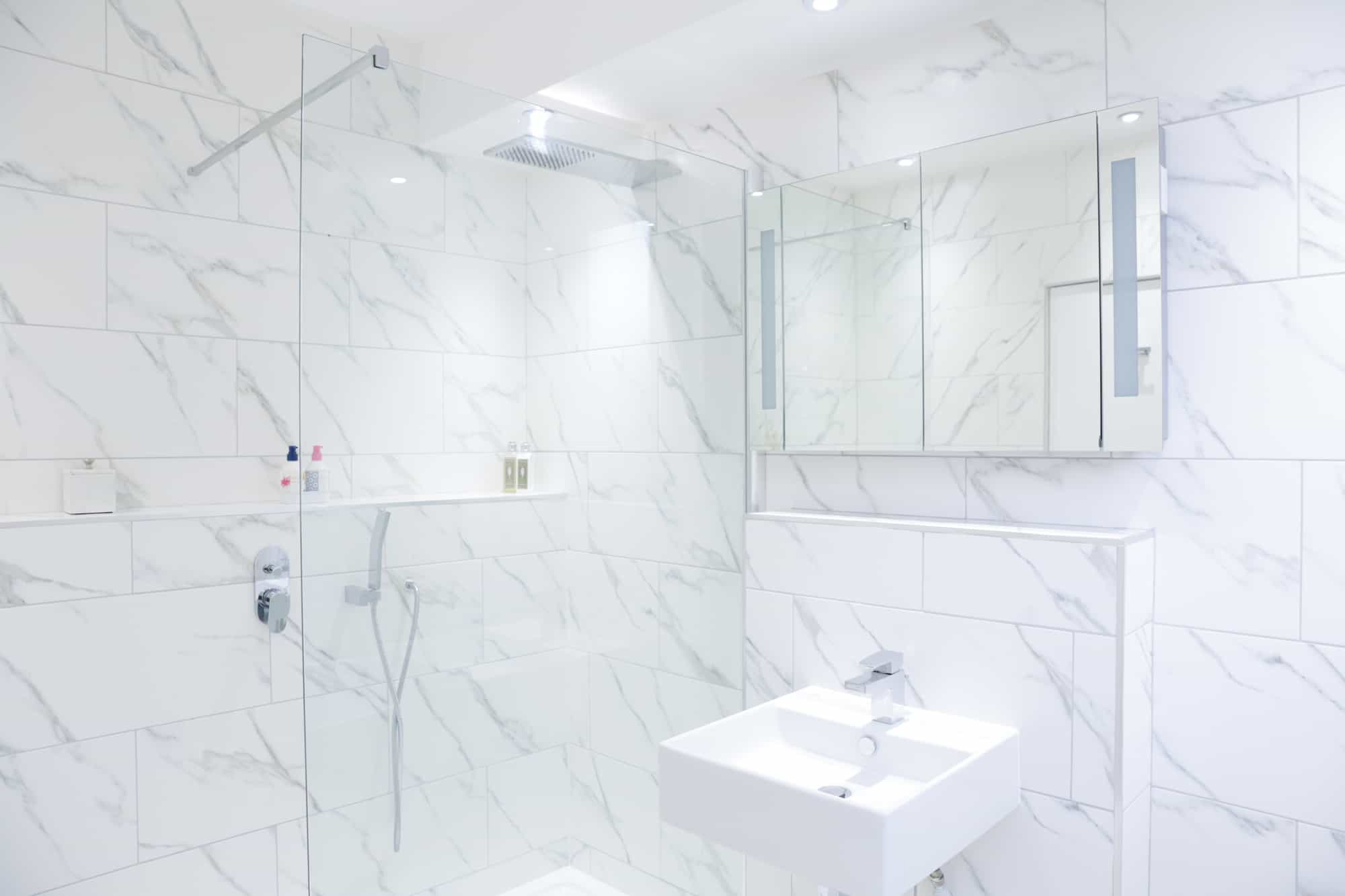 full bathroom installation, white tiles, shower, sink and mirror