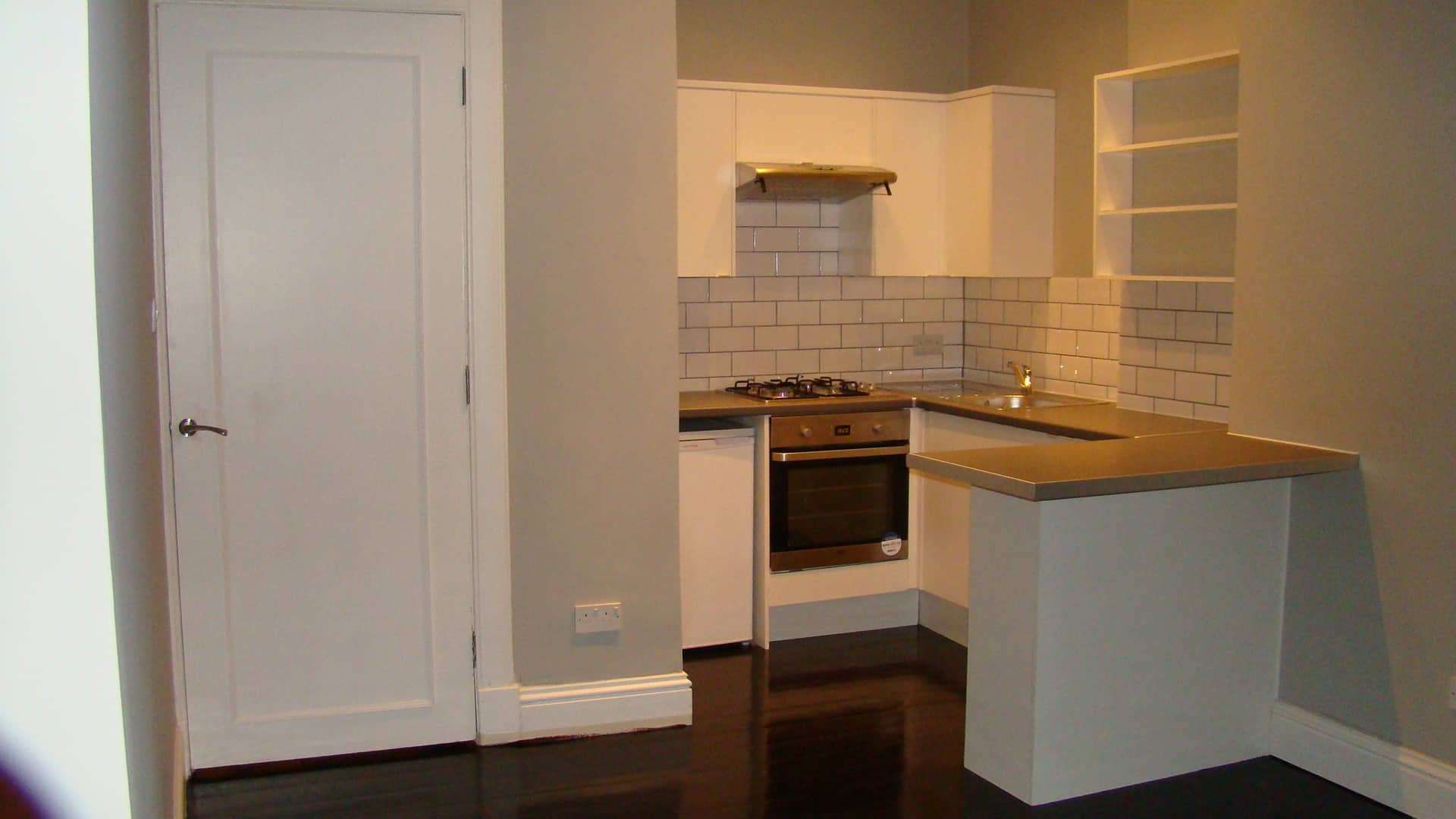 Fully fitted kitchen, new floor, and door.
